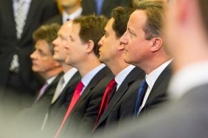 Nick Clegg, Ed Miliband and David Cameron seated together